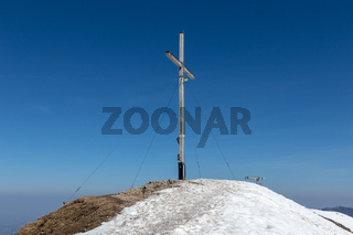 Top and Summit Cross of Jochberg, 1565 m in Winter. Located in Bavarian Prealps near Kochel am See, Upper Bavaria, Germany