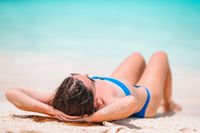 Young beautiful woman on tropical beach vacation