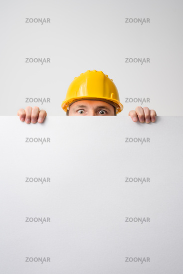 Worker holding blank board on white background