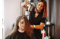 Women using beauty products in salon