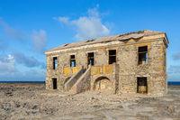 Old historic hotel building as ruin near sea