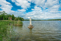 The Wutzsee lake in Lindow with the white nun