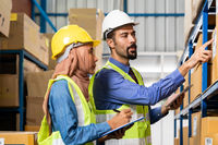 Warehouse manager talk with worker about logistic