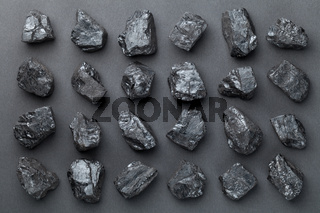 Coal Lumps Over Black Background