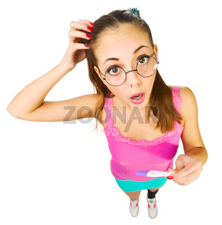Funny schoolgirl in nerd glasses with positive pregnacy test isolated