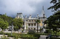 Massandra Palace in the sun on a cloudy day. City of Yalta, Republic of Crimea, Russia. September 8, 2020