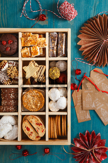 Christmas Shortbread Biscuits Cookies Assortment. Holiday Cookie Box. Assorted Christmas homemade cookies in wooden box. Sweet biscuits in a big wooden box. Christmas dessert table.