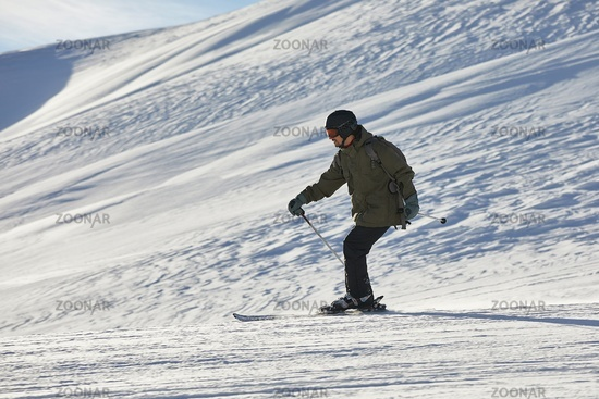 Skiing in the winter snowy slopes