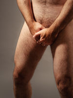 naked man hides his private parts