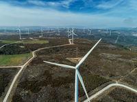 Windmills or wind turbine on wind farm