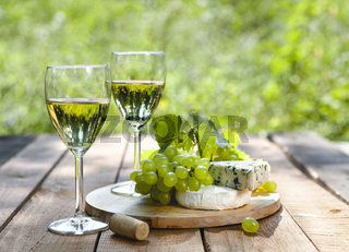 Fresh grape and cheese as appetizer with wine