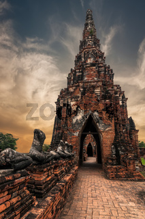 Asian religious architecture. Ancient Buddhist pagoda ruins at Chai Watthanaram temple under sunset sky. Ayutthaya, Thailand travel landscape and destinations