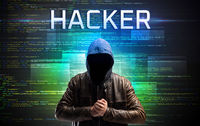 Faceless hacker on code background