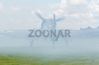 Oostwold, Netherlands May 25, 2015: Corsair covered by smoke