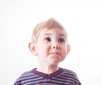 Closeup portrait of a surprised baby boy