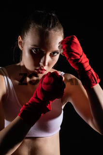 A mixed martial arts fighter. Extreme strength sport for women. MMA sports discipline.