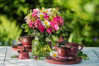 Summer flower bouquet on a garden table