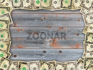 Frame from the dollars on the wooden board background
