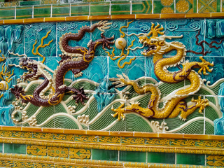 Mosaic of dragons on Chinese sarcophagus. Decorations made of tiles.