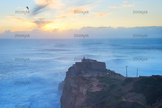 Nazare lighthouse sunset ocean Portugal