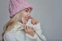 Pretty young blond woman in woollen winter outfit