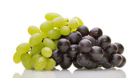 Ripe white and red wine grapes isolated on white background with reflection. Healthy food, grocery,