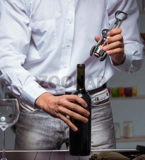 The professional sommelier tasting wine in restaurant