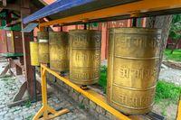 Prayer wheels in buddhist monastery