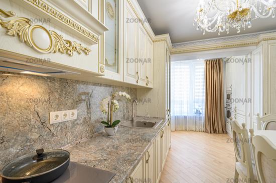 Luxury modern neoclassic beige kitchen interior