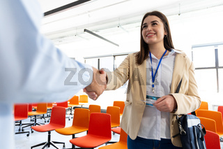 Business people shaking hands in a office
