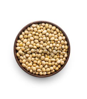 Dried soy beans in bowl isolated on white background.