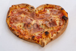 Heart shape ham pizza for Valentines Day concept
