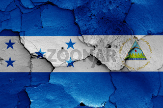 flags of Honduras and Nicaragua painted on cracked wall