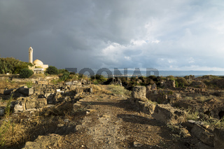 Path with sunlight during storm in ruins with dramatic cloudscape in Tyre, Sour, Lebanon