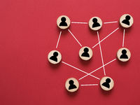 Abstract teamwork, network and community concept on a red paper background