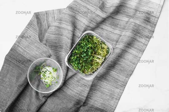 Top view of microgreens on white marble table. Healthy superfood concept