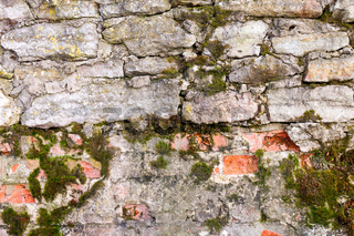 Old weathered grunge stone wall as background