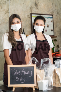 waitress wear protective face mask with take away food