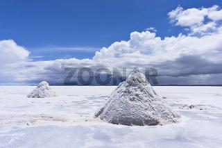 Salar de Uyuni,  horizon cloudscape reflection, Bolivia, salt production, piles of salt, South Ameri