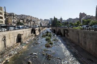 Tripoli, Lebanon: October 9 2015: River with trash in the streets of Tripoli, Lebanon