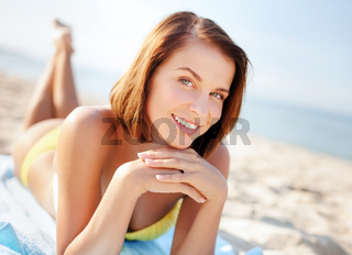 girl sunbathing on the beach