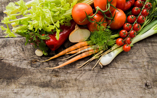 Fresh ripe vegetables on wooden surface, copy space