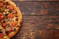 Pizza pepperoni with mozzarella cheese, tomato sauce and salami