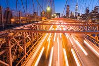 Night lights of car headlamps on the Brooklyn bridge. Long expos