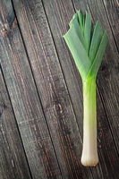 Leek on a wooden background