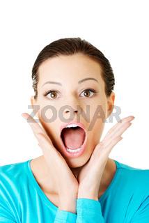 Beautiful casual woman expresses shock.