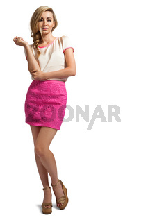 attractive young blonde woman with pink skirt isolated