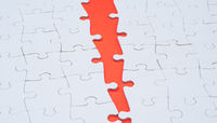 Empty white jigsaw puzzle with a red crack
