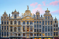 Brussels Grand Place. North-east part. Sunset evening view of row of old beautiful stone buildings facades. Lots of artistic golden details and decorations.