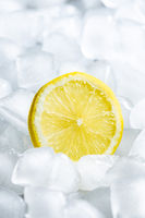 Slice of lemon on ice cubes.